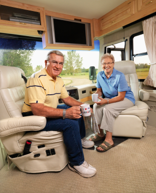 Senior couple sitting in RV.